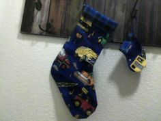 DARK BLUE CONSTRUCTION CHRISTMAS STOCKING AND MATCHING CHRISTMAS STOCKING ORNAMENT/GIFT TAG FOR A BOY OR LITTLE MAN... INSIDE MATERIAL IS BLACK AND BLUE PLAID FLANNEL