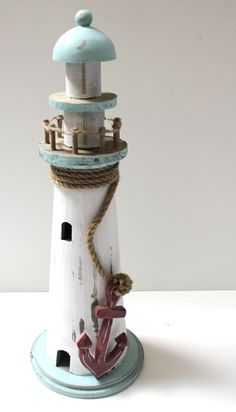 White and Blue Lighthouse with Red Anchor - Nautical Decor (http://www.caseashells.com/white-and-blue-lighthouse-with-red-anchor/)