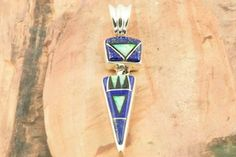 A Calvin Begay pendant -- similar in shape to one I bought in Old Town Scottsdale (AZ).