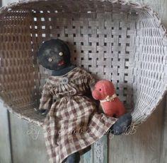 http://www.ebay.com/itm/Primitive-Black-Folk-Art-Doll-w-Early-Straw-Stuffed-Dog-/321637254954?