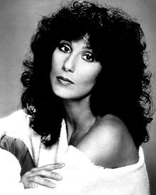 1970s publicity photo of Cher:  an American singer, actress, and television host. Described as embodying female autonomy in a male-dominated industry, she is known for her distinctive contralto singing voice and for having worked in various areas of entertainment, as well as adopting a variety of styles and appearances during her career, which has led to her being nicknamed the Goddess of Pop.