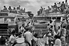 Bangladeshi refugees are moving on the bus during the liberation war of Bangladesh against Pakistan. (1971)  Photographer- Raghu Rai.