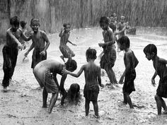 Children Playing in Rain, Bangladesh Photograph by Jashim Salam