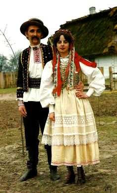 Europe | Portrait of a couple wearing traditional clothes, krzszczonowsko-lubelski, Poland