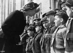 April 26, 1953: Queen Elizabeth II talking to young Cub Scouts at Windsor Castle, her first public engagement following a period of Court Mourning following the death of King George VI.
