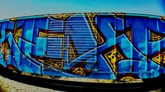 graffiti, blue, multi colored, built structure, architecture, art, creativity, art and craft, building exterior, wall - building feature, street art, abandoned, yellow, day, outdoors, no people, sky, wall, sunlight, low angle view