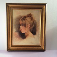 Oil portrait of a faint looking girl, wall decoration in warm natural colors and robust gold colored frame, Dutch, early 20th century.