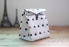 How to make your own fabric gift bags.  http://www.mouthsofmums.com.au/how-to-make-your-own-fabric-gift-bags/