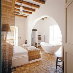 The Seduction of Reduction: Every room in the house opens onto a terrace, including the master bedroom and bath. The floors are paved in handmade Sicilian terra-cotta tiles; the walls are covered in a pristine chalky plaster native to the island.