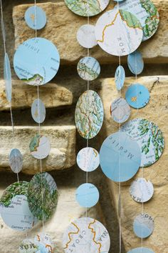 This map garland adds an adventuresome touch to a travel-themed wedding, engagement or baby shower, retirement, or going away party. It is the perfect-sized garland to hang above or drape upon a picnic basket, wooden crate, open vintage suitcase, birdcage, or card box to catch all of those special cards for well-wishes! Alternating 1 and 2 circles are cut from repurposed maps and atlas pages and are sewn with strong white thread to make one 9-foot-long string of map dots. All map garlands…