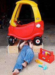 Car Troubles by STL Okie...This reminds me of my son. He used to crawl under anything to fix it...LOL. Love this pic!!!