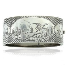 Gorgeous 25mm wide flat hinged bangle with hand engraved hunting scene on top. Hallmarked Chester 1881.