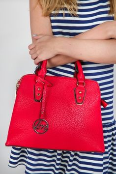 The perfect pop of color! Must have, aurora red handbag! Spring is all about structured bags!