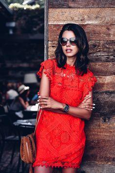 Crochet red dress with pom pom details