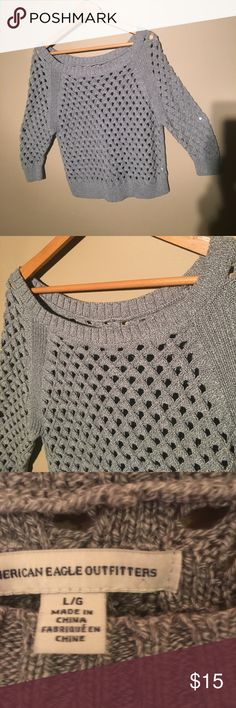 AMERICAN EAGLE OUTFITTERS cable knit sweater L This is a cute gray size L open knit sweater from American Eagle Outfitters.  It has a open Knit and 3/4 length sleeves.  Cute style for the fall. American Eagle Outfitters Sweaters