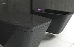 carbon fiber toilets..i guess light weight is in?
