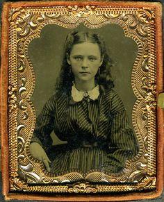 Beautiful young girl in earrings 1860-70