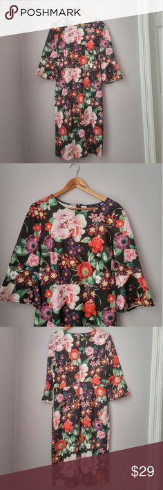 """Floral 3/4 Bell Sleeve Scuba Dress LG NWOT So fun and perfect for Spring! Bust 19.5"""" Length 42"""".95% poly 5% spandex. Back zipper closure.   Bundle for best deals! Hundreds of items available for discounted bundles! Bundle offers welcome.   Follow on IG: @the.junk.drawer Sami + Dani Dresses"""