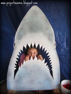 Shark photo booth prop I really wanna do this one though cutting out the teeth might be a challenge but itd be so unique and fun!!