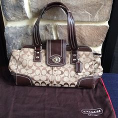 Coach Handbag Brown and tan Coach signature c handbag. Bag has toggle and zip closure. Interior zip pocket and 2 additional pockets. Exterior also has snap buttons to expand the size. Coach Bags Shoulder Bags