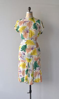 Vintage 1940s lightweight rayon (feels like silk) dress with bright fern print, short dolman sleeves, fitted waist, back bow bustle and back metal
