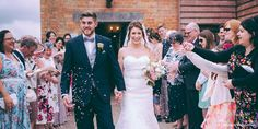 Newlyweds are showered with confetti after their wedding ceremony in the Rickety Barn at Bassmead Manor Barns Country House Wedding Venues, Wrought Iron Chandeliers, Wild Orchid, Exposed Beams, Bridesmaid Dresses, Wedding Dresses, Country Chic, Summer Of Love, Newlyweds