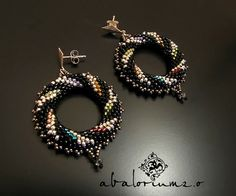Sweet earrings. Loving the muliti-color with the black