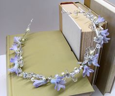 Delicate hyacinth, crystal, and pearl garland for the hair.