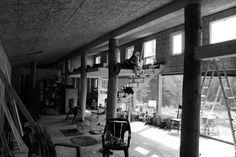Early stages of our earth bermed modified earthship. Local spruce timbers. Way up in the woods of northern Ontario. On sunny winter days, where the outside temperature is -35 degrees celcius and colder...inside our house with no fire going, it is above 25 degrees Celsius..... Why do people build such 'modern' homes above ground with no windows?