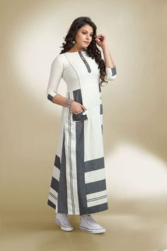 Be the show stopper as you don this smart white & grey geometric print patterns worked designer kurti enhanced with buttons for Kurta Designs Women, Kurti Neck Designs, Dress Neck Designs, Kurti Designs Party Wear, Blouse Designs, Latest Kurti Designs, Abaya Fashion, Indian Fashion, Fashion Dresses