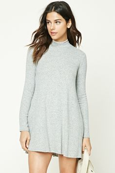 A soft marled knit swing dress featuring a high neckline and long sleeves.  Shop Forever 0aca93c0c
