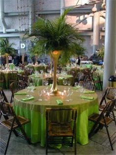 Elegant affordable  Wedding Centerpieces with palm leaves  for Tables   Sometimes all you need is some grand greenery to make a big statement!