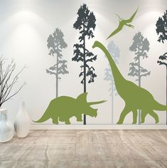 A set of handmade, matte-finish vinyl dinosaur wall decals to Jurassic up any boring wall in a dino-loving child's room. Also, they're easy to remove and won't take the paint off with them.