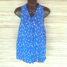 Hollister sailboat tank So cute for summer!! Buttons up but could be left open of course. Hollister Tops Tank Tops