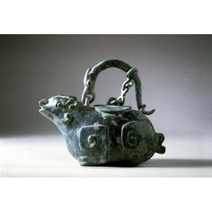 Asian Art Museum Online Collection Vessel (he) with lid Place of Origin: China Historical Period: Warring States Period (approx. 480-221 BCE) Materials: Bronze Dimensions: H. 6 in x W. 7 1/4 in, H. 15 cm x W. 18.4 cm Credit Line: The Avery Brundage Collection Department: Chinese Art Collection: Metal Arts Object Number: B60B5 On Display: No Warring States Period, Asian Art Museum, Online Collections, Art Object, Chinese Art, Metal Art, Tea Pots, Objects