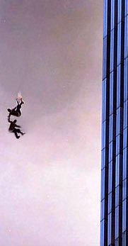 Haunting image from Sept 11: two people holding hands after jumping. it makes me wonder what the story is behind this photo, were they friends or lovers? or just strangers who were too scared to jump alone? it shows that people need a helping hand even in their final moments...
