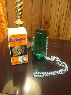 """""""Swinger party glass and chain. Hangs around your neck to keep your hands free.....for better things!"""""""