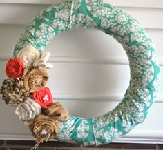 LOVE these wreaths.  Maybe it will make Spring come faster?  spring fling fabric wrapped wreath. $33.00, via Etsy.