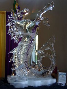 This gold medal winning ice sculpture shows Poseidon's Stallion, roaming the seas. #ice sculpture #TJ Maclaskey #iceworks houston