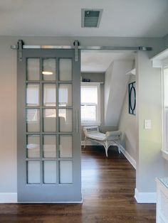A unique take on the traditional barn door provides privacy to the loft bedroom while still connecting to the sitting area.