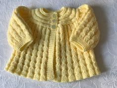 Hand knitted Baby Girls Lemon Shimmer Matinee cardigan fits 0-3 mths 'NEW'
