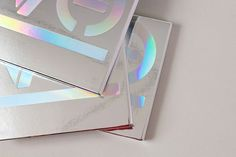 Sleeve design for Halocyan Records, double CD pack. Mirri-board slipcase with holographic foil typography. For packaging design email: hello Hologram Colors, Holographic Print, Holographic Foil, Book Design, Cover Design, Printing And Binding, Print Finishes, Grid Design, Flyer