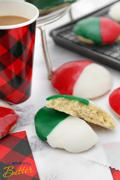 Also called Half-Moons, these rich, buttery cookies have a cake-like texture and colorful frosting. The classic black and white version is glazed with vanilla and chocolate frosting, but this version is dressed for the holidays in red and green!