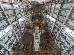 There are two shuttles from the Buran Space Program left and they sit in idle, turning into historic relics, within a forgotten and abandoned building located in Kazakhstan.