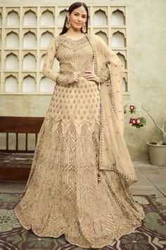 Perfectly cut, this cream beige net anarkali suit which comprises delightful traditional look. This round neck and full sleeve party wear outfit accentuated with zari and stone work. Teamed up with satin churidar in cream beige color with cream beige net dupatta. Churidar is plain. Dupatta beautified with zari and stone work. #anarkalisuit #usa #Indianwear #Indiandresses #andaazfashion Costumes Anarkali, Anarkali Gown, Anarkali Suits, Indian Salwar Kameez, Churidar, Angrakha Style, Floor Length Anarkali, Gowns Online, Traditional Looks