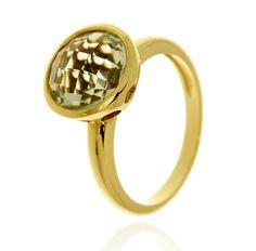 BOTTON Ref: 37986 Sortija realizada en oro amarillo 18 Kts. Lleva una prassiolita en talla briolet, engastada en chatón.