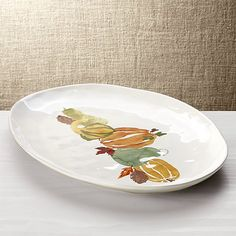 A bounty of painterly gourds in autumnal watercolor hues builds on the organic appeal of our Marin oval platter. Characterized by its free form shape and hand antiquing at the rim, the stoneware platter is crafted by Portuguese artisans.