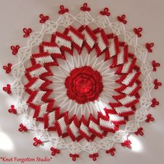 October CAL~ Trick or Treat Doily. From the Facebook Threadies group. I used size 10 Artiste thread in Porcelain and Aunt Lydia's in Victory Red. You can find the free pattern here: http://bellacrochet.blogspot.com/