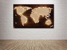 Carte du monde fait main, unique avec un effet d'éclairage et de 3D en noyer-coup d'oeil! Nord et l'Amérique du Sud, Afrique, Eurasie et l'Australie sont un peu élevés et sont éclairés par l'arrière avec un subtil effet d'éclairage LED. Îles mineures sont situés plus profondément et sont