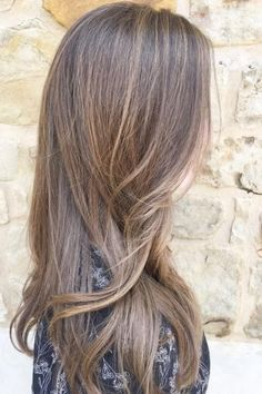 A natural balayage is all you need to mimic beachy, sunkissed highlights for long hairstyles. Angelina Seyler of @hairslayedbyangelina created this perfect light brown color on long hair. Aveda color formula in the comments.